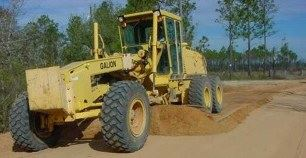 Construction equipment on dirt road